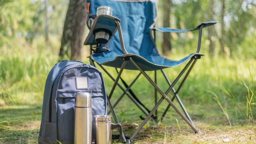 blue backpacking chair and backpack