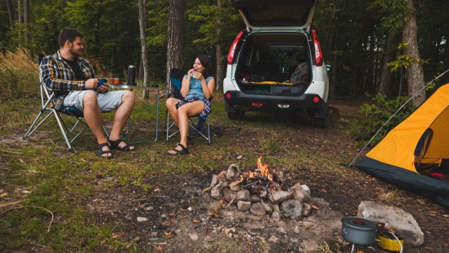 couple sitting on a camping chair