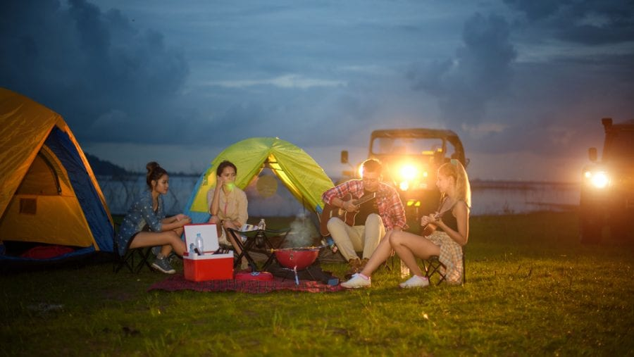 friends car camping with stove and grill