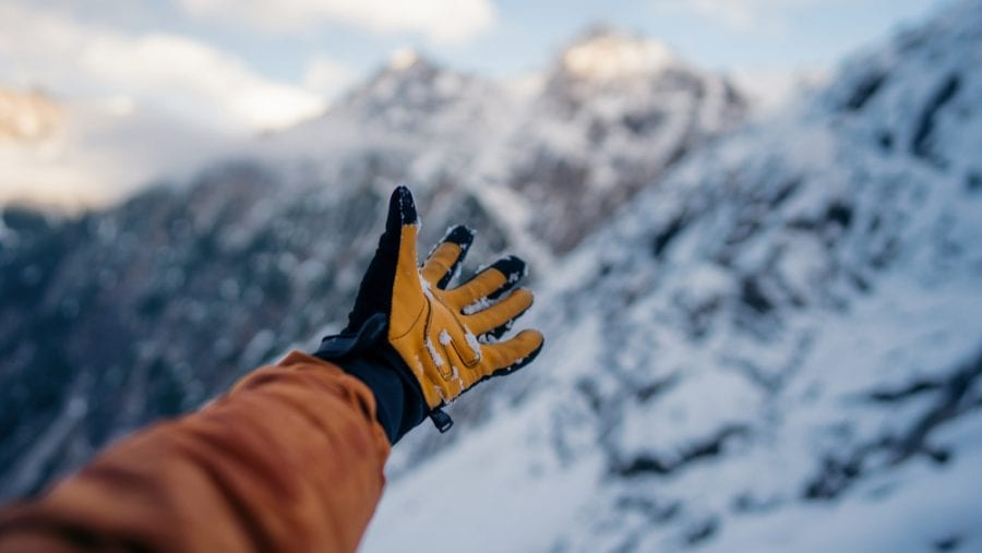 hand with winter hiking gloves