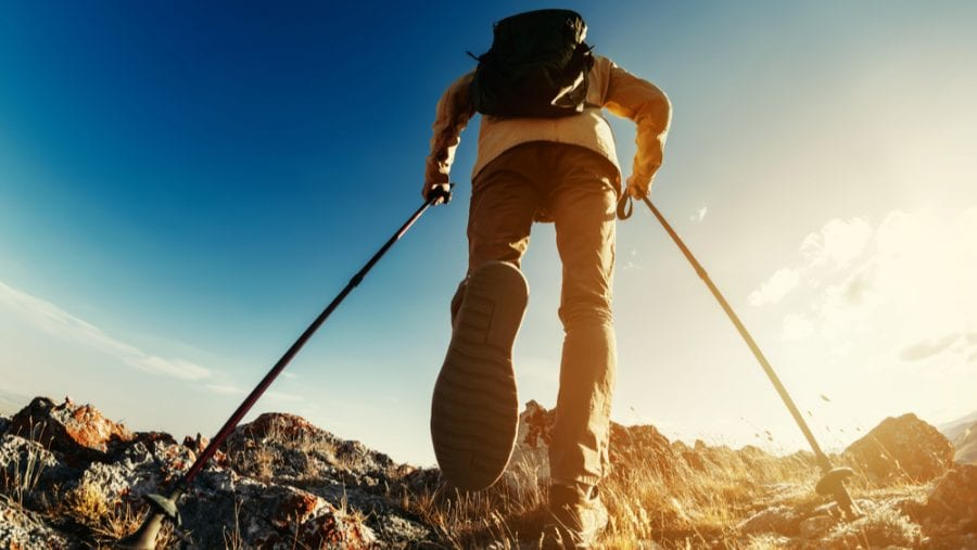 hiker with hiking poles uphill