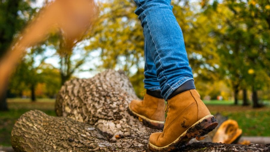 man taking his hiking boots for a casual nature walk