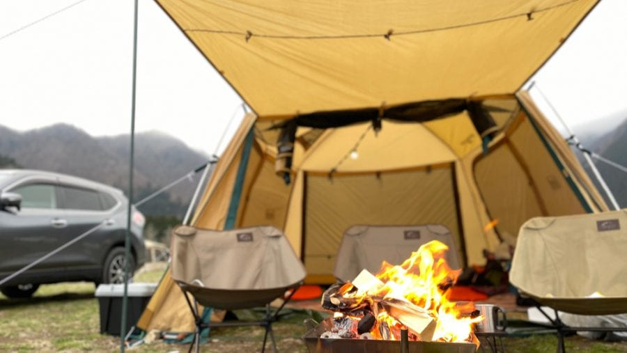tent with yellow tarp cover