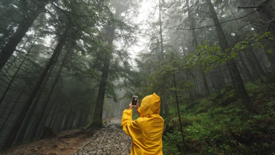 traveller with yellow hiking jacket