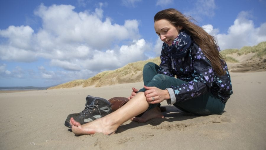 woman taking her hiking boots off for fresh air