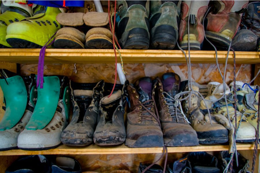Used hiking boots in an outdoor shelf