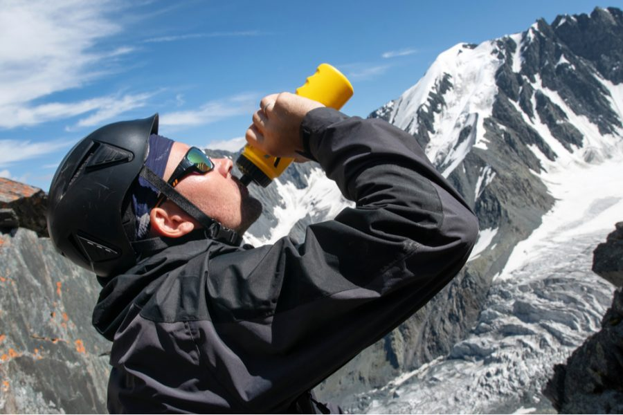 high altitude hiker drinking water