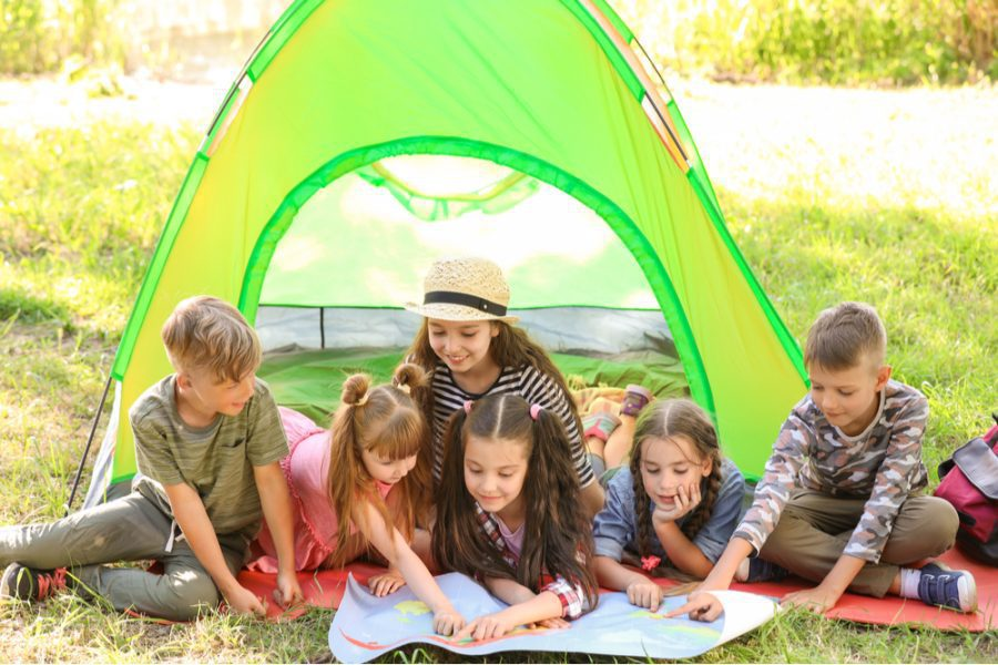 kids having fun looking at the map they created for their camp