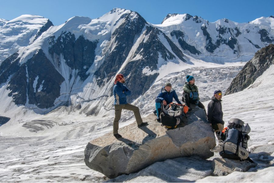 mountain climbers resting in high altitude
