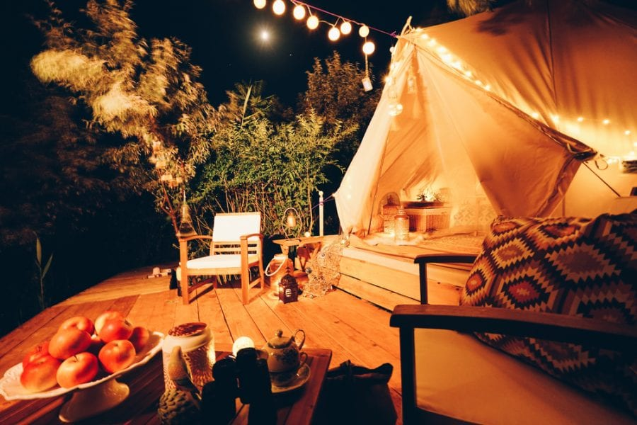romantic glamping tent with string lights