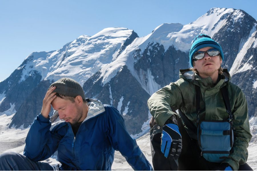 two climbers resting and feeling their mind and body out in high altitude