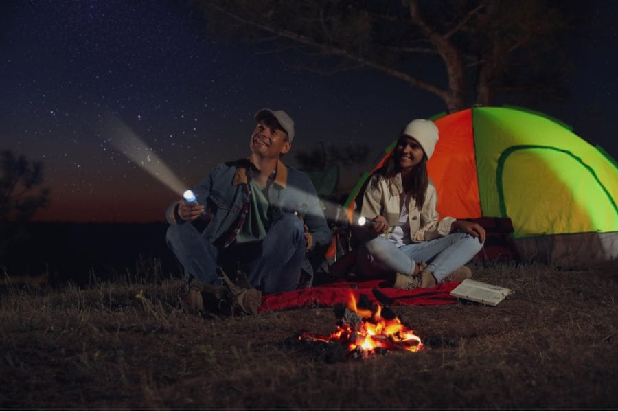 couple with camping flashlights