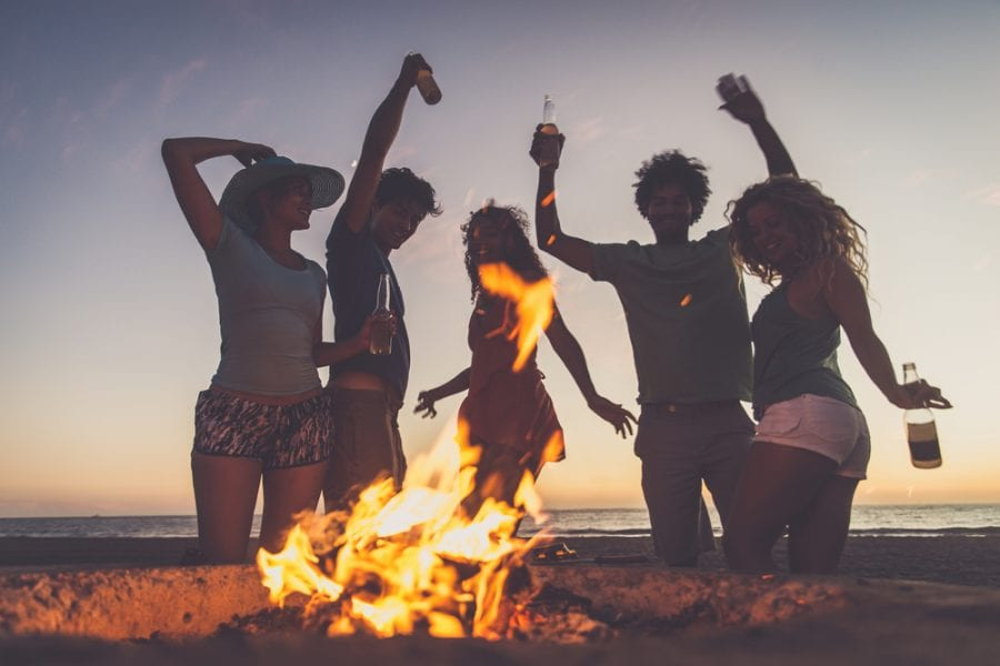 group partying on a small bonfire