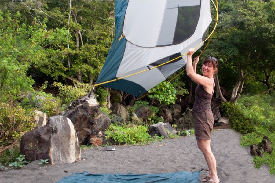 woman carrying a lightweight 2 person tent